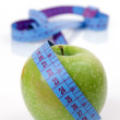 Apple and tape measure - Stok fotoğraf