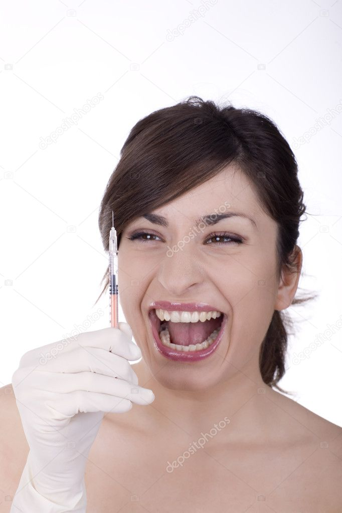 A young woman holding an syringe  Stock Photo #2008758