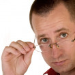 Man holding eyeglasses — Stock Photo