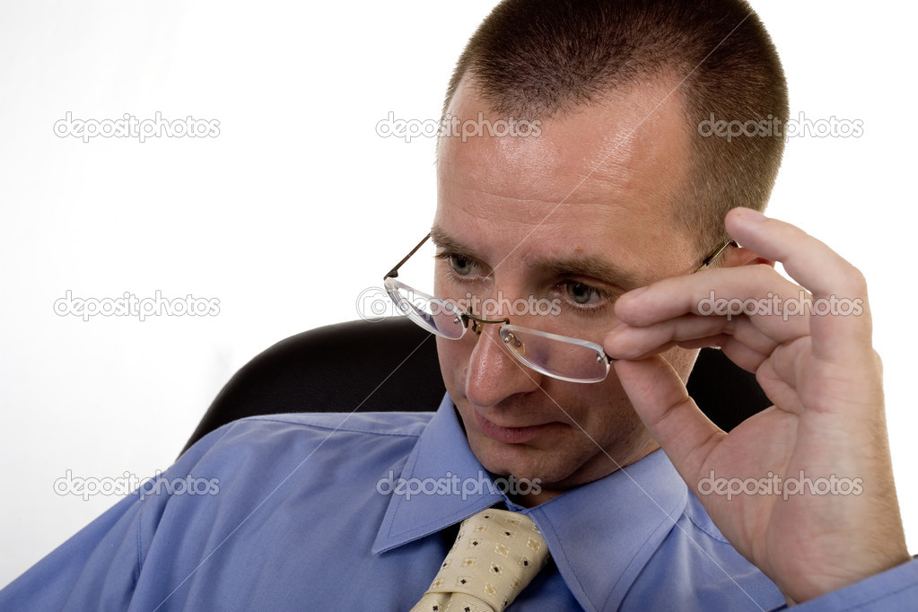 Worried businessman holding his eyeglasses — Stock Photo #2017279