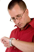 Worried man looking at watch — Stock Photo