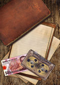 Vintage old paper and book on wood — Stockfoto