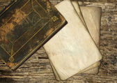 Vintage old paper and book on wood — Stock Photo
