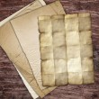 Vintage papers on wood - Stock Photo