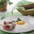 Fried egg with bacon — Stock Photo