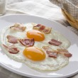 Fried eggs with bacon — Stock Photo
