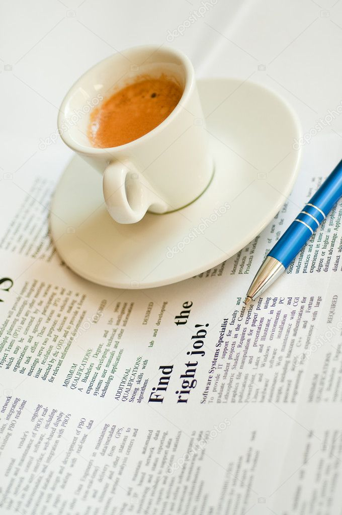 Finding a job with cup of coffee and newspaper — Stock Photo #1804501