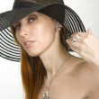 Woman in hat and costume jewellery — Stock Photo