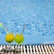 Glasses  with cocktail on edge of pool — Stock Photo
