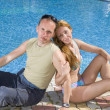 Attractive Couple has a rest at pool - Stock Photo