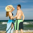 Sports man and  woman on seeshore - Stock Photo