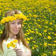 Young woman in wreath of dandelions — Stock Photo