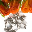 Bouquet  and a jeweller ornament — Stock Photo