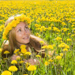 Girl among dandelions — Stock Photo