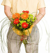 Man keeps bouquet — Stock Photo