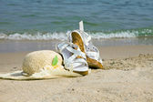 Straw hat and sandal — Stock Photo