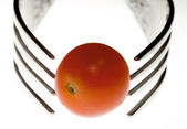 Two plugs and one tomato cherries — Stock Photo