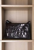 Elegant varnished leather handbag — Stock Photo