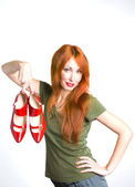 Beautiful woman with red shoes — Stock Photo