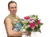 Man with a bouquet — Stock Photo