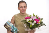 The smiling man with a bouquet — Stock Photo
