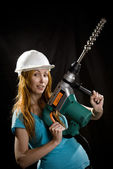 The builder in a protective helmet — Stock Photo