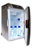 Refrigerator with bottles of water — Stock Photo