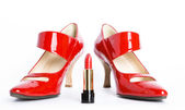 Red shoes and red lipstick — Stock Photo