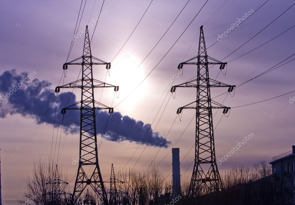 Pipe with smoke and line of electricity transmission on background of city  Stock Photo #1780009