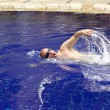 The young sports man floats in pool — Stock Photo #1818515