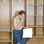 Man studies plan of assembly of furnitur — Stock Photo #1818998