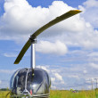 Helicopter on Field solar day - Stock Photo