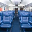 Numbers of empty seats in car of train — Foto Stock