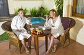 Attractive pair drinks tea on rest — Stock Photo