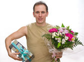 Man with a bouquet and a gift box — Stock Photo