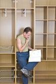 Man studies plan of assembly of furnitur — Stock Photo