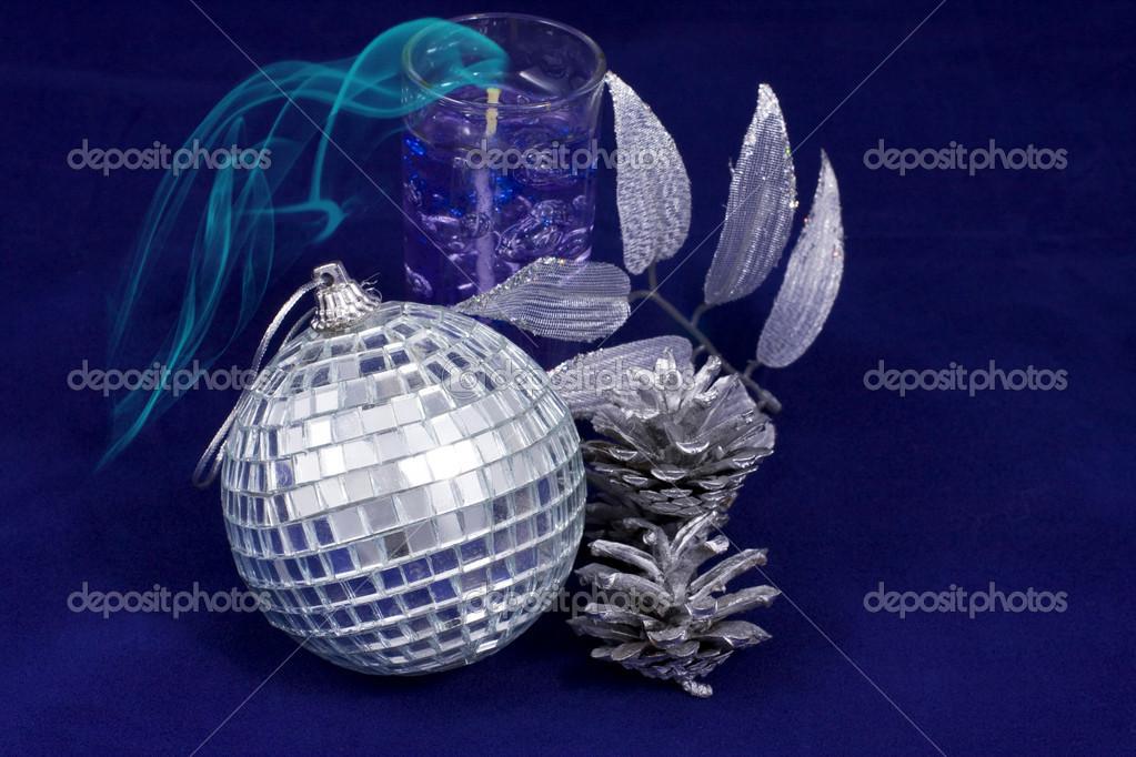 Silvery New Year's ball and candle on a dark blue background — Stock Photo #1818614