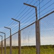 Royalty-Free Stock Photo: Fence with a barbed wire