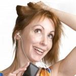Nice woman listens music — Stock Photo