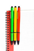Notebook and 3 colored pens — Stock Photo