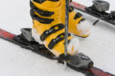 Mountain-skiing boot on snow — Stock Photo
