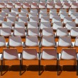 Stock Photo: Empty rows of seats backs to spectator