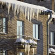 Stock Photo: Huge icicles hang down from roof