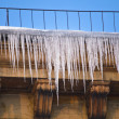 Huge icicles hang down from roof — Stock Photo #2195779