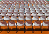 Empty rows of seats backs to spectator — Stok fotoğraf