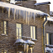 Huge icicles hang down from roof — Stock Photo #2383363