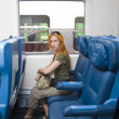 Interior of a passenger train with woman — Stock Photo