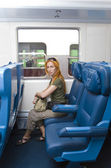 Interior of a passenger train with woman — Стоковое фото