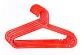 Red plastic hangers — Stock Photo