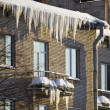 Huge icicles hang down from roof — Stock Photo #2437759